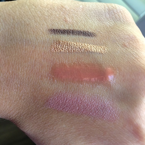 From top: Smashbox liner, Laura Mercier stick, bareMinerals gloss, Tarte lipstick