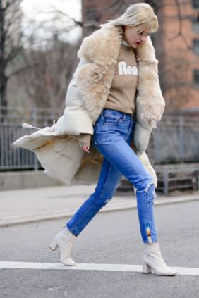 white-booties-high-waisted-mom-jeans-graphic-sweatshirt-fur-trim-jacket-parka-nyfw-street-style-elle